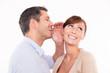 mann whispering woman
