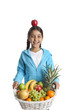 Funny girl with a fruit basket