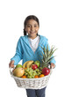 Smiling little girl with a fruit basket