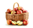 Apples and wicker basket isolated on white