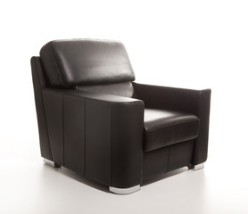 A studio shot of a leather black armchair isolated on white back