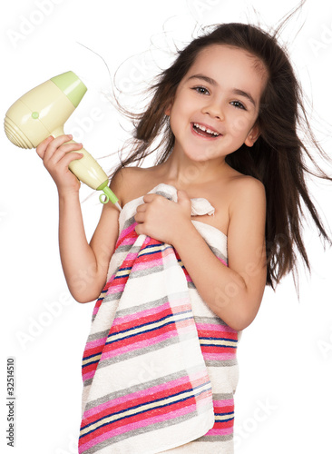 Little girl with hairdryer