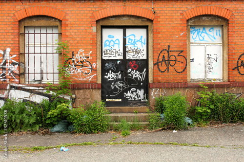 brick house and graffiti