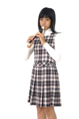 Young asian girl is playing on a flute