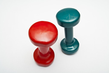 Red and green dumbbells hand weight.
