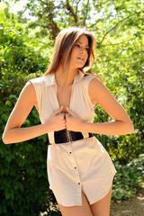 Beautiful model posing outdoors in a park