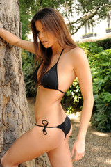 A fashion model wearing a bikini in outdoor shoot