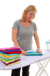 housewife folding clothes over white background