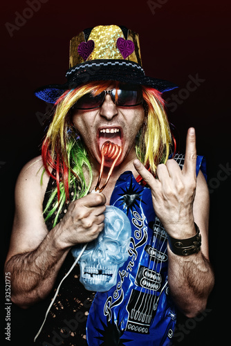 Crazy rock star burning his tongue with hot electric heater