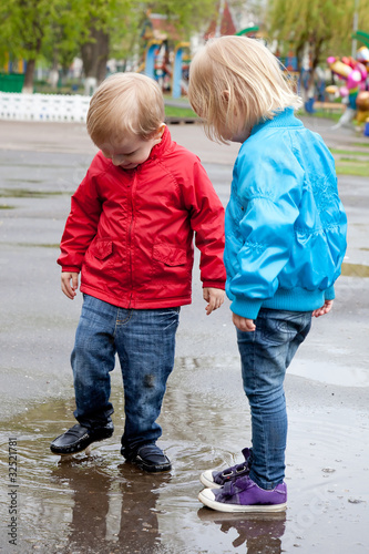 Boy with girl are walking on the street