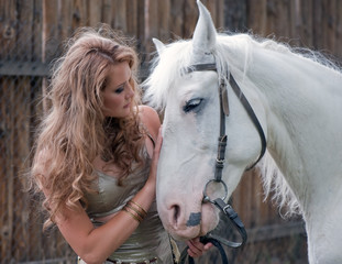 Rural pretty girl with a stallion