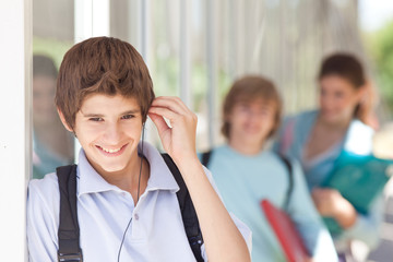 Boy listening to music outdoors