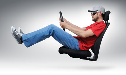 Cool dude with the wheel flies on an office chair concept