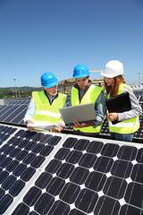 Group of engineers meeting on building roof
