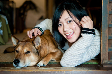 beautiful asian woman and dog