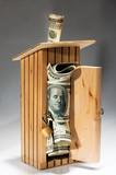 Wooden moneybox full of money poster