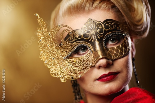 Close-up portrait of a beautiful woman in carnival mask