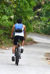 men rides a bike
