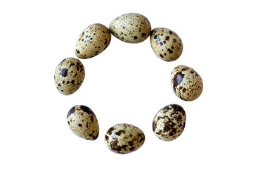 Quail eggs in the circle isolated on white background