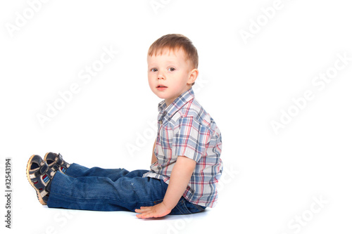 Cute little boy sitting looking at camera. concept.
