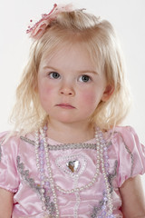 portrait of litle girl with pouting facial expression
