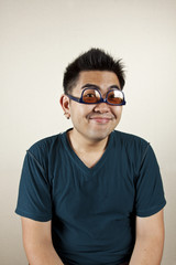 Funny face, A man wear eyeglass upside down smile.