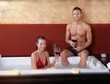 Portrait of happy couple in jacuzzi