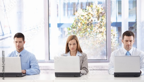 Young businesspeople sitting in meeting room