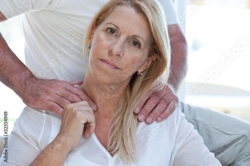 Man putting hands on shoulders of his wife
