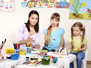 Child painting in preschool.