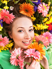 Young woman in flowers.