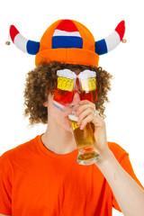 Dutch sports fan is drinking beer