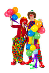 Couple funny clowns with balloons