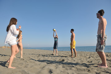 young people group have fun and play beach volleyball