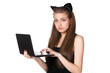 Portrait of female wearing pussycat ears working on laptop