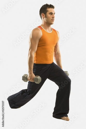 A Man Exercising With Free Weights
