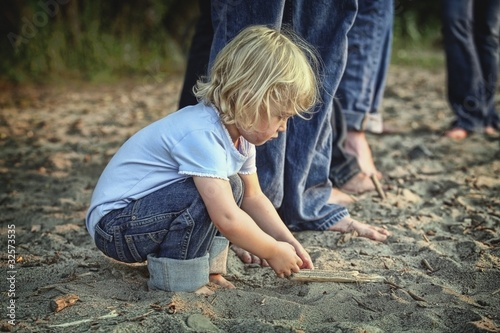 St. Catharines, Ontario, Canada; A Child Playing In The Sand