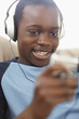 Black boy enjoying music on headphones