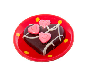 a lovely chocolate heart decorated white pink hearted candy on a