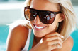 Happy young lady with sun glasses