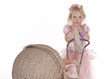 pretty little girl with security blanket and baby carriage