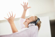 Joyful girl wearing headphone and listening music