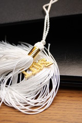 white graduation tassle
