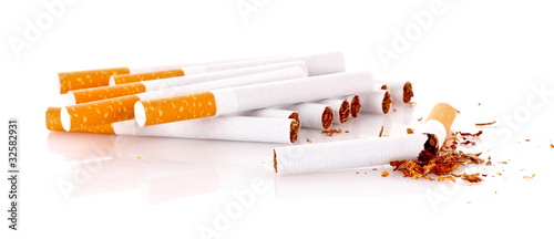 Many cigarettes isolated on white