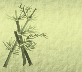 Silhouette of branches of a bamboo on paper background . © xiaoliangge