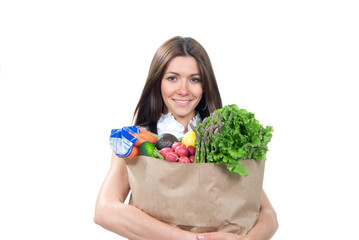 woman holding a supermarket shopping bag full of groceries