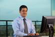 Latino Businessman Working Looking at Camera Horizontal