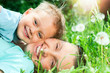 Cute boy with mother lying in the grass