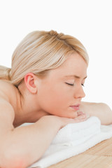 Young pretty blonde woman relaxing in a spa centre