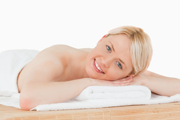 Young pretty blonde woman posing in a spa centre